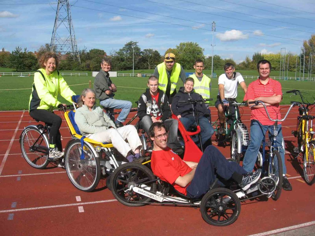 Group of cyclists at leisure centre with different types of bike